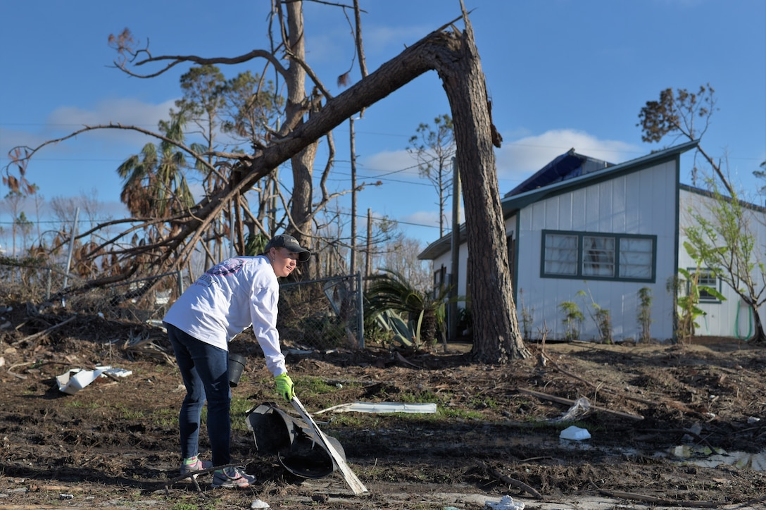 Jennifer Whitesides, a bioenvironmental engineer technician with the 325th Aerospace Medicine Squadron, helps clean Under the Palms Park in Mexico Beach, Fla. Dec. 16, 2018. Thirty nine volunteers from Tyndall and Eglin Air Force Bases came together to help clean Mexico Beach, one of the communities hit the hardest by Hurricane Michael. The volunteers were able to clean up more than 40 cubic yards of debris within four hours. (U.S. Air Force photo by Tech. Sgt. Sara Keller)