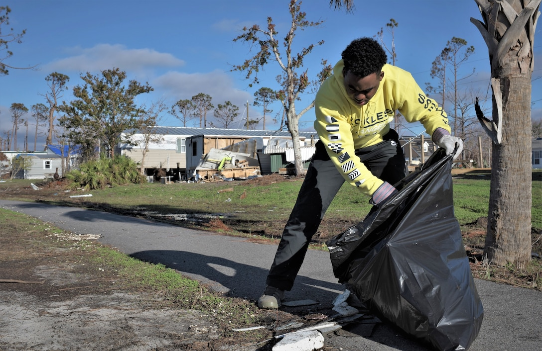 Airman 1st Class Tristain Blaney, 325th Force Support Squadron, Fitness Assessment Cell trainee, helps clean Under the Palms Park in Mexico Beach, Fla., Dec. 16, 2018. Thirty nine volunteers from Tyndall and Eglin Air Force Bases came together to help clean Mexico Beach, one of the communities hit the hardest by Hurricane Michael.  The volunteers were able to clean up more than 40 cubic yards of debris within four hours. (U.S. Air Force photo by Tech. Sgt. Sara Keller)
