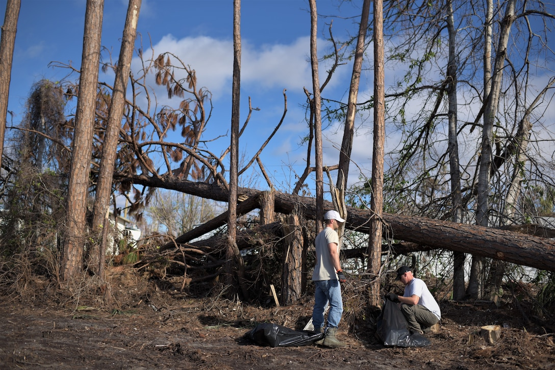 Two volunteers from Tyndall Air Force Base clean debris from Under the Palms Park in Mexico Beach, Fla., Dec. 16, 2018. Thirty nine volunteers from Tyndall and Eglin Air Force Bases came together to help clean of Mexico Beach, one of the communities hit the hardest by Hurricane Michael.  The volunteers were able to clean up more than 40 cubic yards of debris within four hours. (U.S. Air Force photo by Tech. Sgt. Sara Keller)