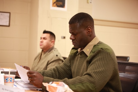 U.S. Marine Corps Maj. Derek George, a Marine Air-Ground Task Force plans officer with U.S. Marine Corps Forces South, reads a packet during a Security Cooperation Planners Course, Dec. 12, 2018, at Marine Corps Security Cooperation Group Headquarters, Joint Expeditionary Base Fort Story, Virginia Beach, Virginia. MCSCG organized this course. MCSCG is an organization with three key elements: the Coordination, Liaison and Assessment Training Teams, the Training Instructor Group, and the Security Assistance Branch. It helps uphold security cooperation in the Marine Corps, and also provides training to all branches of the U.S. military and civilian equivalents. (U.S. Marine Corps photo by Cpl. Danielle Prentice/ Released)