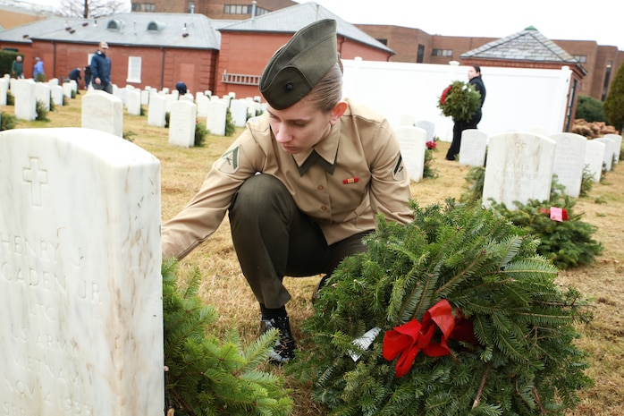 HAMPTON, Va. — Lance Cpl. Crystal Bulger, a data systems administrator with Headquarters and Service Battalion, U.S. Marine Corps Forces Command, lays a wreath on a grave while volunteering in a wreath-laying ceremony for Wreaths Across America, Dec. 15, 2018, at the Hampton National Cemetery in Hampton, Virginia. The wreath-laying ceremony is an annual event that encourages volunteers to help place wreaths at veterans' grave sites across the United States, helping remember and honor them and their service. (U.S. Marine Corps photo by Cpl. Danielle Prentice/ Released)