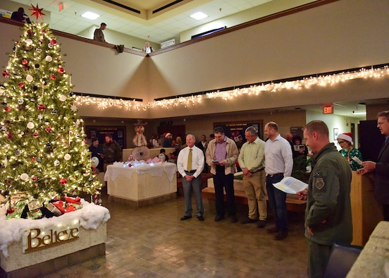 Col. Brian Laidlaw, 325th Fighter Wing commander, right, is joined by local civic leaders in singing holiday songs at the 75th Annual Christmas Tree Lighting ceremony at Tyndall Air Force Base, Fla., Dec. 14, 2018. The ceremony included an invocation, comments by the commander, the tree lighting, and Christmas sing along paired with the arrival of Santa Clause. (U.S. Air Force photo Senior Airman Isaiah J. Soliz)