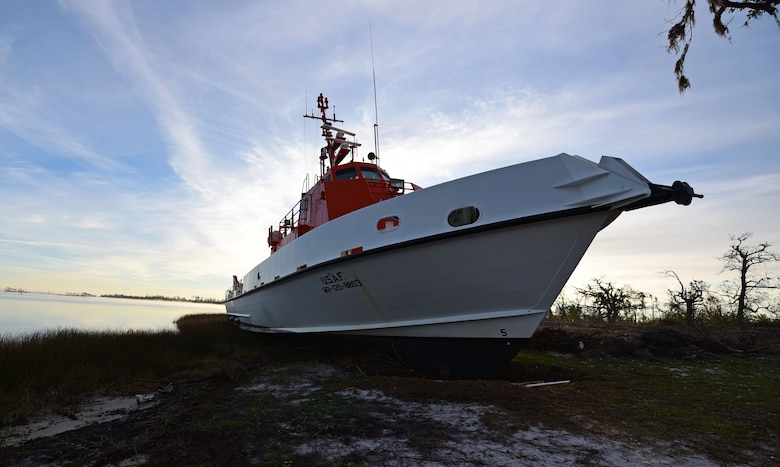 A U.S. Air Force Missile Retriever Ship attached to the 53rd Weapons Evaluation Group sits beached near Tyndall Air Force Base, Fla., Dec. 12, 2018. The vessel was run aground during the powerful winds of Hurricane Michael. The Missile Retriever ship is responsible for the location and recovery of Subscale Aerial Targets in the Gulf of Mexico W151 Live-Fire Range. MR's also conduct launch and recovery corridor clearance operations for both SSAT and Full-scale Aerial Target Missions. (U.S. Air Force photo by Senior Airman Isaiah J. Soliz)