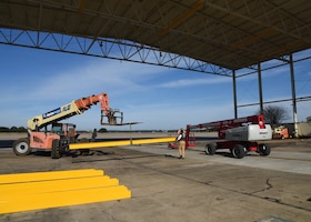 The 403rd Wing replaced the safety harness feature in the Wash Rack at Keesler Air Force Base Dec. 10-13, 2018. The C-130J Super Hercules aircraft are washed every 30 days and with the new safety feature contractors will be able to wash the aircraft more thoroughly as well as safely. (U.S. Air Force photo by Maj. Marnee A.C. Losurdo)