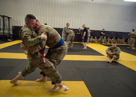 Senior Airman Derrik Felton, 15th Aerospace Medicine Squadron bioenvironmental engineering technician, practices clinch fighting during a level-two Tactical Combatives Course at Schofield Barracks, Hawaii, Dec. 12, 2018. Clinching positions are designed to give a controlled position for striking. Joint training events, like the Tactical Combatives Course, help facilitate partnerships between service branches and foster a warrior ethos in Airmen. (U.S. Air Force photo by Tech. Sgt. Heather Redman)