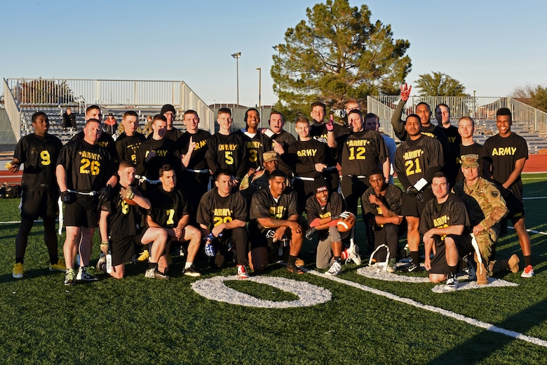 U.S. Army team poses for a photo after winning the Army-Navy game at the Mathis Fitness Center field on Goodfellow Air Force Base, Texas, Dec. 14, 2018. The Army won by a score of 13-7, dethroning the Navy. (U.S. Air Force photo by Airman 1st Class Zachary Chapman/Released)