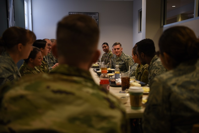 U.S. Air Force Gen. Timothy Ray, Air Force Global Strike Command commander, visits with Airmen during breakfast at F.E. Warren Air Force Base, Wyo., Dec. 11, 2018. During the visit, Ray emphasized the importance of exhibiting excellence as professional warfighters, building integrated teams, and developing people both personally and professionally to produce trained and ready Airmen. (U.S. Air Force photo by Airman 1st Class Abbigayle Wagner)