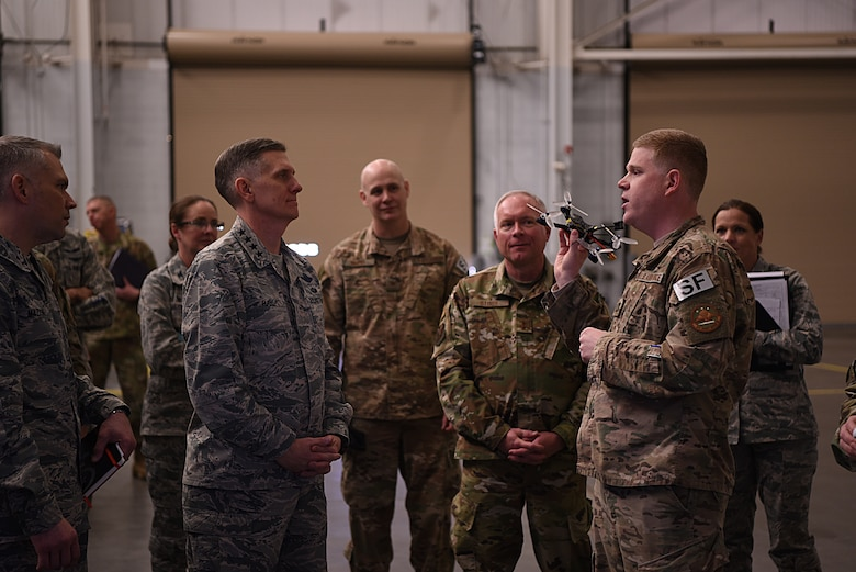 U.S. Air Force Gen. Timothy Ray, Air Force Global Strike Command commander, receives a demonstration of unmanned aerial systems from Capt. Timothy Marriner, 90th Security Support Squadron operations officer, at F.E. Warren Air Force Base, Wyo., Dec. 11, 2018. During the visit, Ray emphasized the importance of focusing the command's energy on excellence, including the relentless pursuit of improvement with available resources, to remain the most feared and respected warfighting force the world has ever seen. (U.S. Air Force photo by Airman 1st Class Abbigayle Wagner)