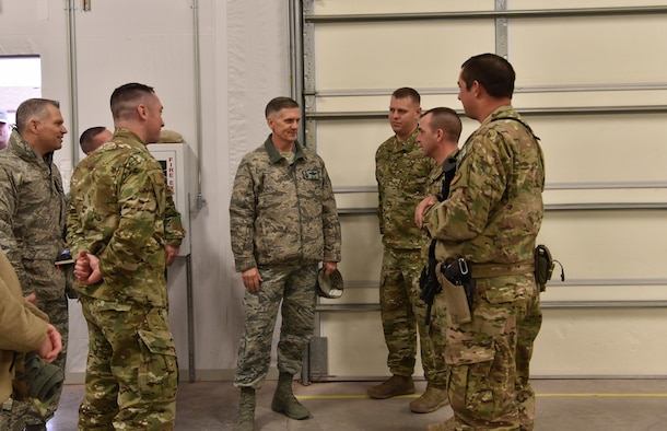U.S. Air Force Gen. Timothy Ray, Air Force Global Strike Command commander, visits with Airmen and receives a briefing on security forces combatives at Camp Guernsey Joint Training Center, Wyo., Dec. 12, 2018. During the visit, Ray also received a mission brief covering Camp Guernsey's role in mission execution, and the newest training tactics used by Airmen to sustain high performance in demanding mission sets. (U.S. Air Force photo by Airman 1st Class Braydon Williams)