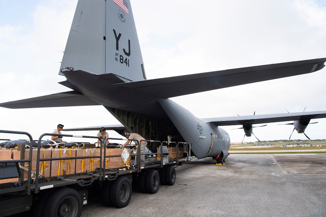 U.S. Air Force air transportation specialists with the U.S. Air Force Reserve's 44th Aerial Port Squadron load a U.S. Air Force C-130J Hercules Dec. 11, 2018, with airdrop bundles for airdrop during Operation Christmas Drop at Andersen Air Force Base, Guam. Operation Christmas Drop is a U.S. Air Force-led trilateral training event that includes air support from the Japanese Air Self Defense Force and Royal Australian Air Force to airdrop supplies to the Commonwealth of the Northern Marianas, Federated States of Micronesia, and the Republic of Palau. (U.S. Air Force photo by Jerry R. Bynum)