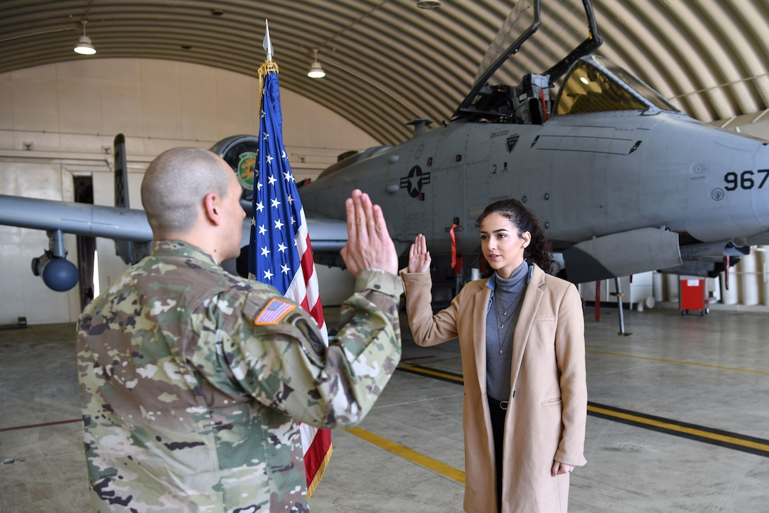 Samantha De La Rosa, right, recites the oath of enlistment with her father, U.S. Army Maj. Rudy De La Rosa, 8th Army director of policies, programs and awards, at Osan Air Base, Republic of Korea, Dec. 10, 2018. Samantha is a fourth generation service member in her family, ranging back to her great grandfather who was in the U.S. Navy during World War II. (U.S. Air Force photo by Senior Airman Kelsey Tucker)