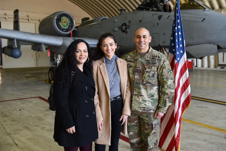(Left to right) Mia De La Rosa, Samantha De La Rosa, and U.S. Army Maj. Rudy De La Rosa pose for a photo after Samantha's swearing-in at Osan Air Base, Republic of Korea, Dec. 10, 2018. After several failed attempts at enlisting in the U.S. Army and the U.S. Marine Corps due to her behavioral health records, Samantha was finally accepted into the U.S. Air Force. (U.S. Air Force photo by Senior Airman Kelsey Tucker)