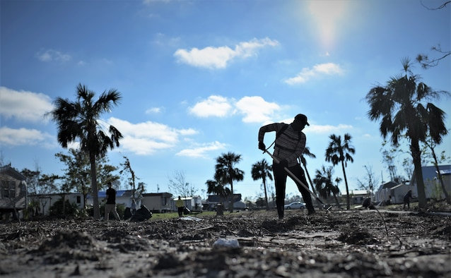 An Airman from Tyndall Air Force Base cleans debris from Under the Palms Park in Mexico Beach, Fla., Dec. 16, 2018. Thirty nine volunteers from Tyndall and Eglin Air Force Bases came together to help clean Mexico Beach, one of the communities hit the hardest by Hurricane Michael.  The volunteers were able to clean up more than 40 cubic yards of debris within four hours. (U.S. Air Force photo by Tech. Sgt. Sara Keller)