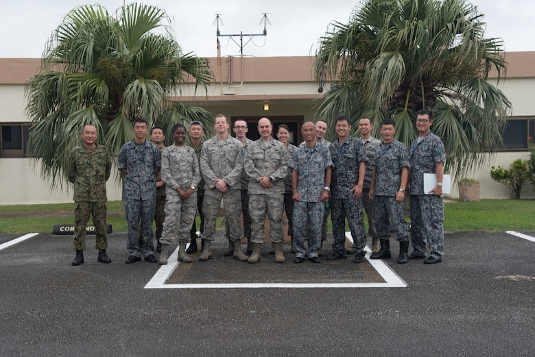 U.S. Air Force Airmen and Japan Air Self-Defense Force members pose for a group photo during the Alliance Coordination Mechanism Sept. 26, 2018, at Kadena Air Base, Japan. The ACM provides a means for U.S. military and JASDF members to discuss topics ranging from logistics to medical capabilities, furthering the understanding and interoperability between the two countries.