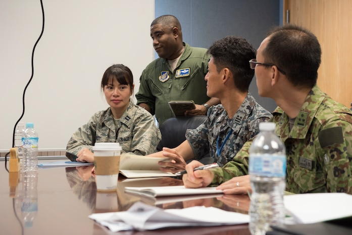 U.S. Air Force Airmen and Japan Air Self Defense Force members communicate during the Alliance Coordination Mechanism Sept. 26, 2018, at Kadena Air Base, Japan. Both countries worked to strengthen cooperation by mutually sharing information and enhancing situational awareness.