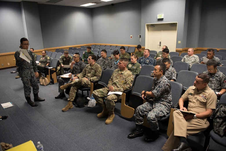 A member of the Japan Air Self-Defense Force speaks to U.S. military and other JASDF members during the Alliance Coordination Mechanism Sept. 26, 2018, at Kadena Air Base, Japan. Both countries worked to strengthen cooperation by mutually sharing information and enhancing situational awareness.