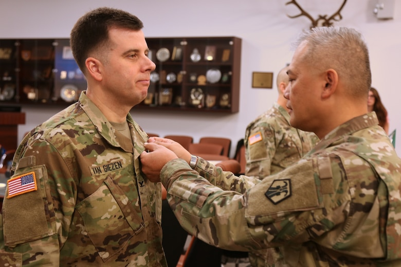 Colonel Edward Van Giezen receives the Meritorious Service Medal for his leadership of the 7th Intermediate Level Education Detachment.  Van Giezen handed off command to Lt. Col. Michael Hiller at a ceremony at 7th Army Training Command headquarters at Grafenwohr Training area, Grafenwohr, Germany on December 12, 2018.  Van Giezen will now head Human Resources for the 7th Mission Support Command.