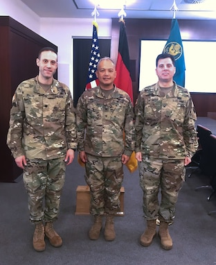 Colonel Edward Van Giezen hands off command of the 7th Intermediate Level Education Detachment to Lt. Col. Michael Hiller at a ceremony at 7th Army Training Command headquarters at Grafenwohr Training area, Grafenwohr, Germany on December 12, 2018.  Van Giezen will now head Human Resources for the 7th Mission Support Command.