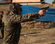 A U.S. Marine with the ground combat element of Special Purpose Marine Air-Ground Task Force- Crisis Response- Africa (SPMAGTF-CR-AF) 19.1 qualifies on the Beretta M9 pistol at Etna Range, Sicily, Italy, Nov. 22, 2018