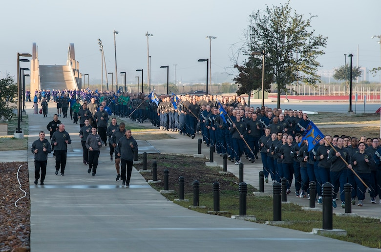 433rd Training Squadron military training instructors (left) call out cadence and encourage their trainees (right) during the pre-basic military training graduation Airmen's run at Joint Base San Antonio-Lackland, Texas Dec. 13. (U.S. Air Force photo by Johnny Saldivar)