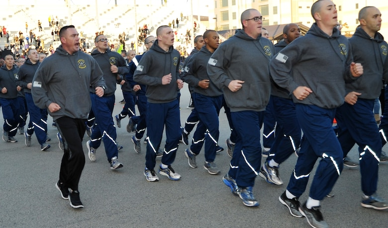 Basic military training students and their military training instructor from the 433rd Training Squadron run in formation during the pre-basic military training graduation Airmen's run at Joint Base San Antonio-Lackland, Texas Dec. 13. (U.S. Air Force photo by Debbie Gildea)