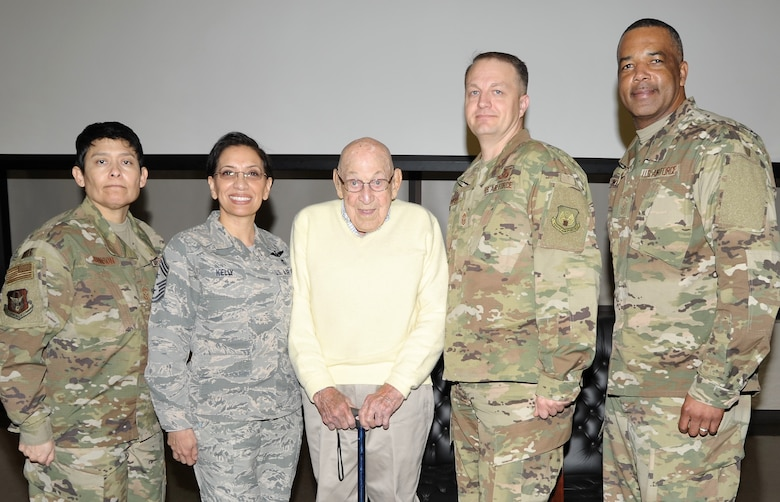 Retired Lt. Col. Dick Cole, the last living member of the World War II Doolittle Raiders, poses with Reserve Citizen Airmen command chief master sergeants following the pre-basic military training graduation Airman's coin ceremony at Joint Base San Antonio-Lackland, Texas Dec. 13. Pictured with Colonel Cole are (left to right) Chief Master Sgt. Imelda Johnson, 22nd Air Force command chief; Chief Master Sgt. Ericka Kelly, Air Force Reserve Command command chief; Chief Master Sgt. James Loper, 10th Air Force command chief; and Chief Master Sgt. Timothy White, 4th Air Force command chief. (U.S. Air Force photo by Debbie Gildea)