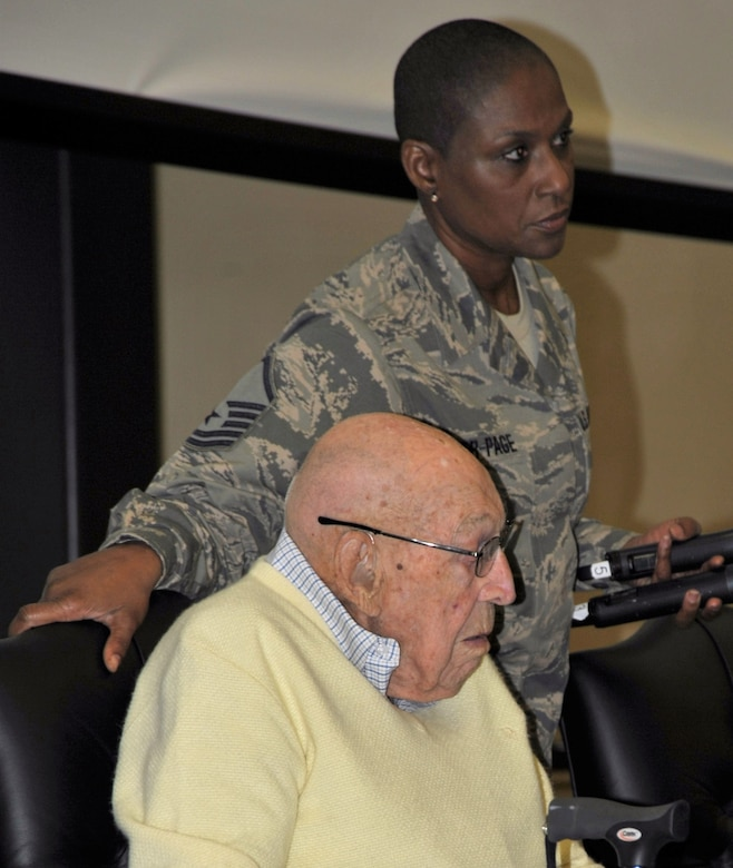 Master Sgt. Rosalind Rider-Page, 433rd Training Squadron, prepares to assist Retired Lt. Col. Dick Cole from the stage following his question-and-answer session at Joint Base San Antonio-Lackland on Dec. 13. Colonel Cole is the last living member of the World War II Doolittle Raiders. He and his daughter were special guests of the 433rd Training Squadron during basic military training graduation week activities. (U.S. Air Force photo by Debbie Gildea)