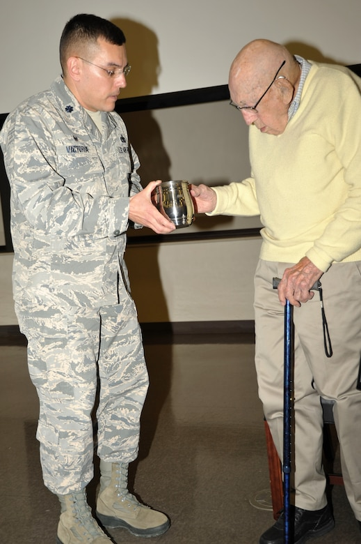 "Retired Lt. Col. Dick Cole, the last living member of the World War II Doolittle Raiders was a special guest of the 433rd Training Squadron during basic military training graduation week activities. Following a question and answer session, 433rd TRS Commander Lt. Col. Christopher Victoria presented Cole with a memento to remind him of his visit with the 433rd ""Raiders"" at Joint Base San Antonio-Lackland, Texas Dec. 13. (U.S. Air Force photo by Debbie Gildea)"