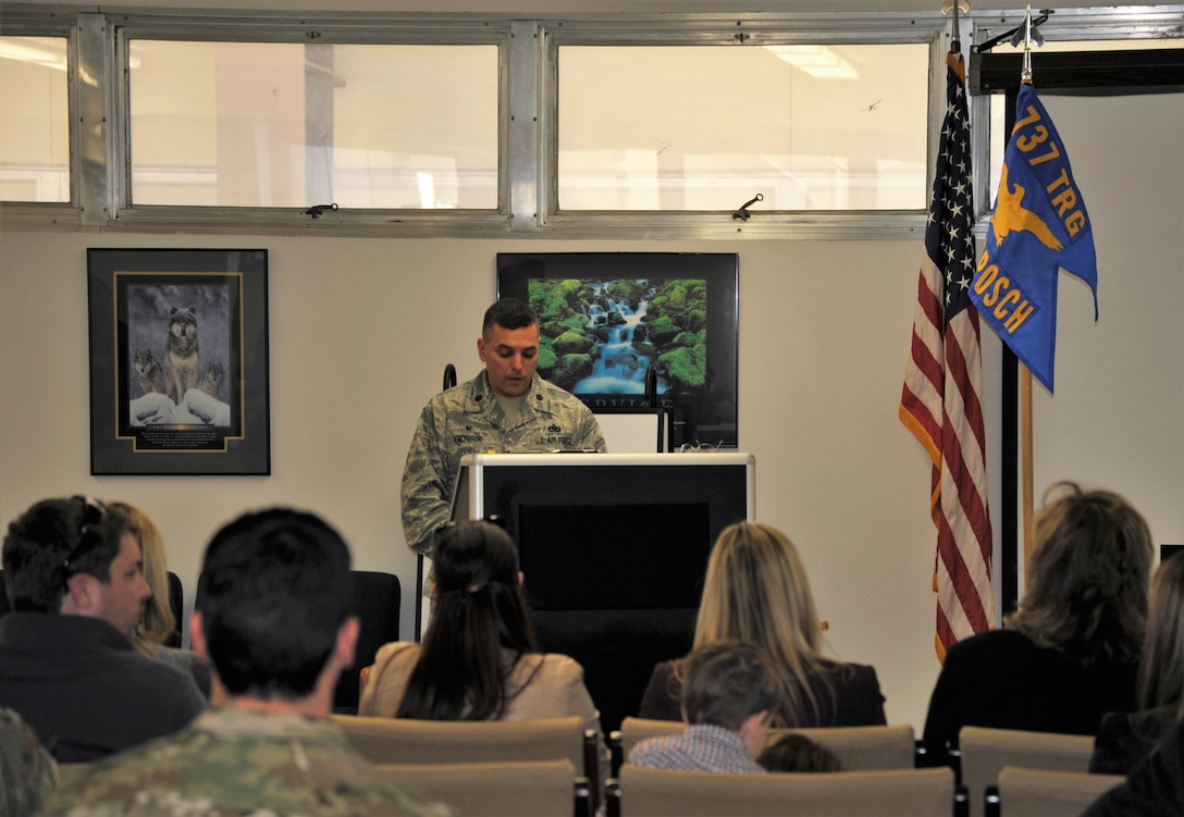 Lt. Col. Christopher Victoria, 433rd Training Squadron commander, welcomes guests to the basic military training flight dedication ceremony held Dec. 13 at Joint Base San Antonio-Lackland, Texas, during which the squadron honored Chief Master Sgt. Ericka Kelly, command chief for Air Force Reserve Command, and three fallen Reserve Citizen Airmen killed in the line of duty. Basic military training flights are traditionally dedicated to enlisted Airmen who have made significant contributions to the nation and the service. (U.S. Air Force photo by Debbie Gildea)