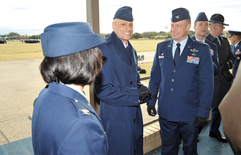 Col. Allen Duckworth, 433rd Flying Training Group (right) and group senior leaders chat with Col. Jason Corrothers, 737th Training Group commander, prior to the Dec. 14 basic military training graduation at Joint Base San Antonio-Lackland, Texas. The 433rd Training Squadron, a subordinate unit of the 433rd, graduated four BMT flights during the ceremony - a first in the squadron's 35-year history. (U.S. Air Force photo by Debbie Gildea)