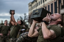 Marines with Marine Forces Reserve perform ammo can lifts during the Combat Fitness Test at Marine Corps Support Facility New Orleans, Dec. 14, 2018. The CFT is an annual fitness assessment comprised of a simulated movement to contact, which is an 880-meter sprint; 2 minutes of 30-pound ammo can lifts, and a maneuver under fire, which is a timed 300-yard shuttle run of combat-related tasks. (U.S. Marine Corps photo by Cpl. Tessa D. Watts)
