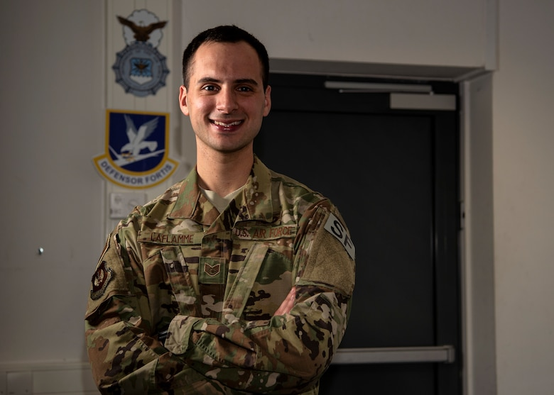 U.S. Air Force Staff Sgt. Zachary LaFlamme, 702nd Munitions Support Squadron Custody Forces flight sergeant, poses for a photo at Buechel Air Base, Germany, Dec. 13, 2018. His identical twin brother, Staff Sgt. Jacob LaFlamme, is stationed two-and-a-half hours away. Zachary joined the military to gain knowledge to become a state trooper after his enlistment. (U.S. Air Force photo by Airman 1st Class Valerie Seelye)