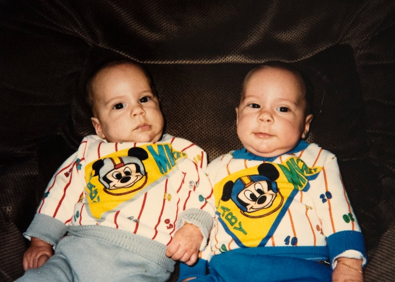 Four-month-old identical twins, Jacob LaFlamme, left, and Zachary LaFlamme, right, pose for a photo. The brothers are now both U.S. Air Force staff sergeants who hold the same job, certifications, and are both stationed at 52nd Fighter Wing geographically separated units. Their mother dressed them in matching outfits until they were two years old. (Courtesy photo provided by Staff Sgt. Zachary LaFlamme)