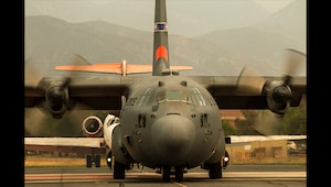 MAFFS 9, a modular airborne firefighting system-equipped C-130 from the 152nd Airlift Wing, Nevada Air National Guard, taxis after picking up a load of fire retardant, Wednesday, August 8, 2018, at the U.S. Forest Service San Bernardino Airtanker Base in San Bernardino, California, while battling the Holy Fire in Southern California. The crew consisted of specially-trained Air National Guardsmen from the Nevada and Wyoming Air National Guards. (U.S. Air National Guard photo by Senior Airman Crystal Housman)