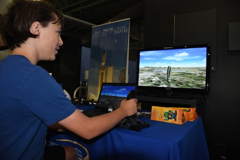 DAYTON, Ohio -- A museum visitor using a flight simulator at the National Museum of the U.S. Air Force. (U.S. Air Force photo)