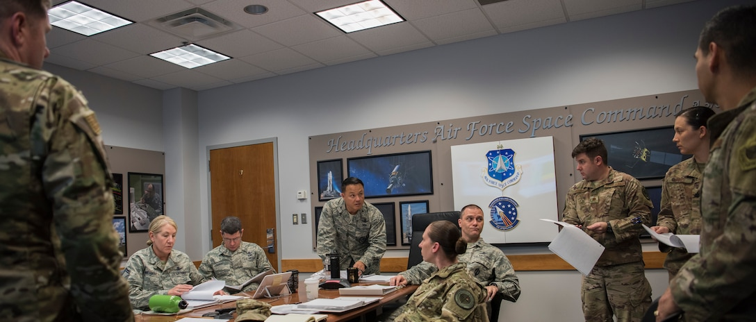 A selection board for the emerging 1C6 Space Warfighter Advanced Instructor Course (AIC) meets at Peterson Air Force Base, Colorado, Nov. 29, 2018.  The group, comprised of representatives of Air Force Space Command and the Air Force Weapons school, chose six enlisted instructors for the course.  Classes are expected to begin in July 2019 at Nellis Air Force Base, Nevada.  (U.S. Air Force photo by Dave Grim)