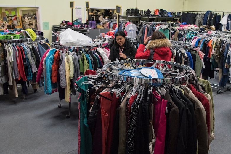 Customers shop at the Fort Richardson Thrift Shop, Joint Base Elmendorf-Richardson, Alaska Dec. 12, 2018. The store is open to all branches of active duty, the National Guard, Reserve, retired military personnel, their dependents and anyone with access to JBER.