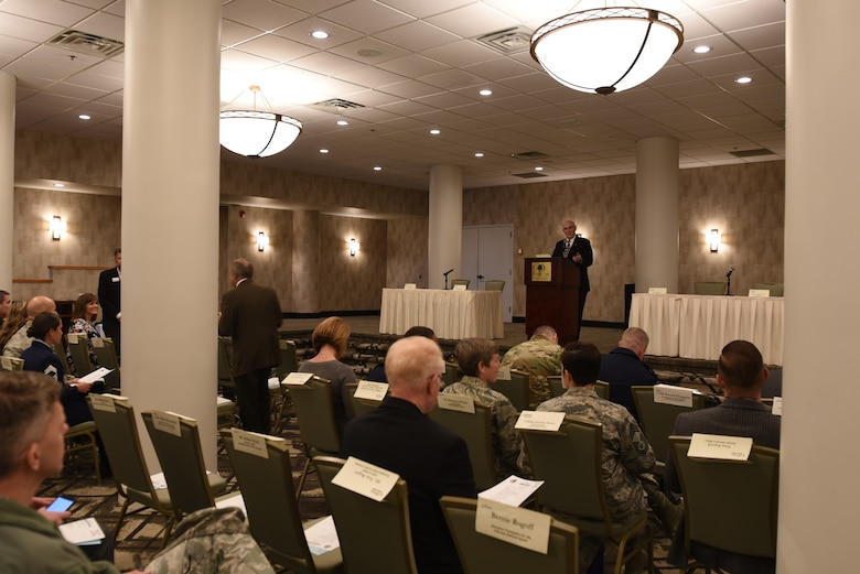 Ron Cole, Aurora Defense Council chairman, gives opening remarks to councilmembers during an ADC meeting December 13, 2018, at the Double Tree by Hilton in Aurora, Colorado.