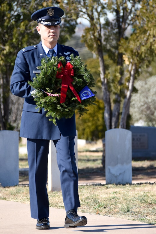U.S. Air Force Col. Ricky Mills, 17th Training Wing commander, shows honor and respect for veterans and active duty members serving in the Air Force with a wreath symbolizing that branch of the armed forces during the Wreaths Across America ceremony at Belvedere Memorial Cemetery, San Angelo, Texas, Dec. 15, 2018. Other leaders from Goodfellow each laid a wreath representing all veterans and duty members from the different branches. (U.S. Air Force photo by Airman 1st Class Seraiah Hines/ Released)