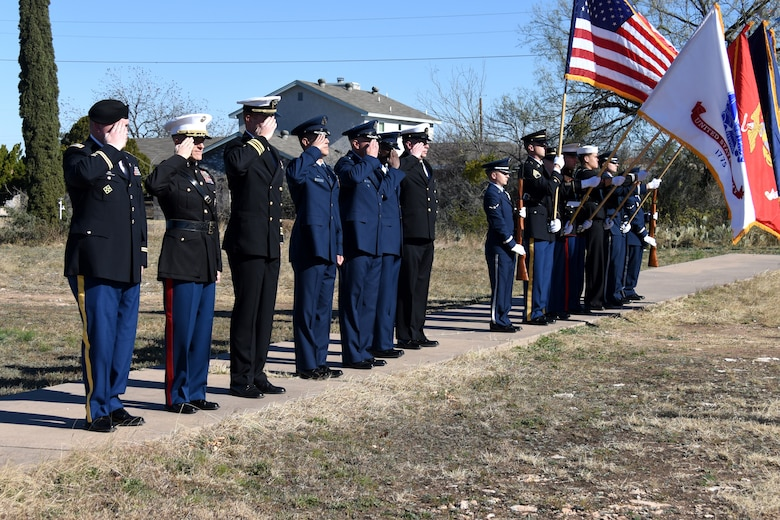 Leaders from Goodfellow salute as the Goodfellow Joint Service Color Guard retires the colors and taps is played, honoring veterans who gave the ultimate sacrifice for freedom at the Wreaths Across America ceremony held in the Belvedere Cemetery, San Angelo, Texas, Dec. 15, 2018. After the ceremony members from the base and community laid wreaths on the gravestones of veterans as a way to honor them and their sacrifice. (U.S. Air Force photo by Airman 1st Class Seraiah Hines/ Released)