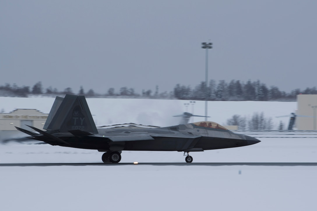 A U.S. Air Force F-22 Raptor assigned to the 95th Fighter Squadron from Tyndall Air Force Base, Florida, taxis on the runway at Joint Base Elmendorf-Richardson, Alaska, Dec. 17, 2018.