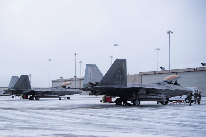U.S. Air Force F-22 Raptors assigned to the 95th Fighter Squadron from Tyndall Air Force Base, Florida, sit on the flightline after landing at Joint Base Elmendorf-Richardson, Alaska, Dec. 17, 2018.