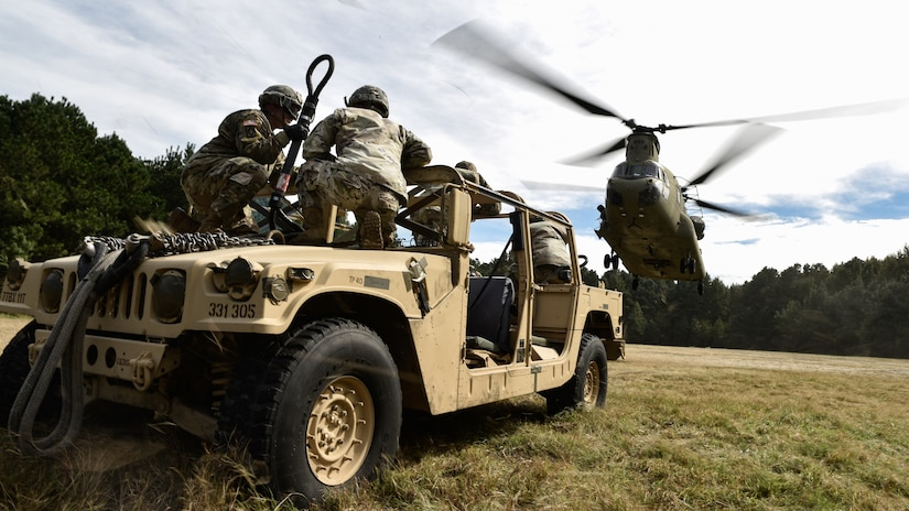 U.S. Army Soldiers from the 11th Transportation Battalion, 7th Transportation Brigade (Expeditionary), conduct sling load operations during a training exercise at Joint Base Langley-Eustis, Virginia, Oct. 17, 2018. The training will conclude with a two-week field training exercise to prepare Soldiers within the battalion for future deployments. (U.S. Army photo by Spc. Travis Teate)