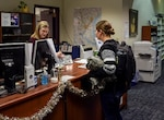 Jan Curtis, a library technician at the Staff Sgt. Paul D. Savanuck Memorial Library at the Defense Information School on Fort Meade, Md., processes a book returned by a student, Air Force Airman Destani K. Matheny, on Dec. 6, 2018. Curtis began her career as a classroom teacher and subsequently discovered a rewarding career in libraries.