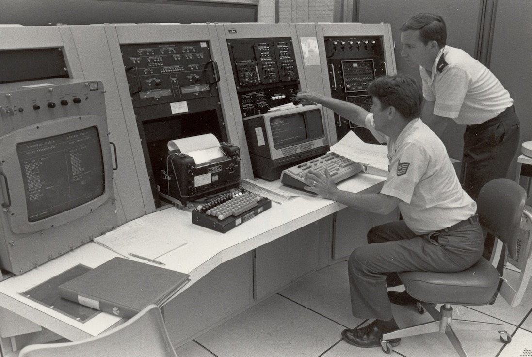 An AFSATCOM programmer, TSgt Otis Smith, operates the AFSATCOM simulator while 2d Lt Rick Mahoney, Test Analyst watches.  The simulator is capable of reproducing the necessary inputs and outputs that show real-world choices that can be handled by radio receiver, transmitter, and satellite equipment, Tinker AFB, Oklahoma, 12 Aug 1983. 
