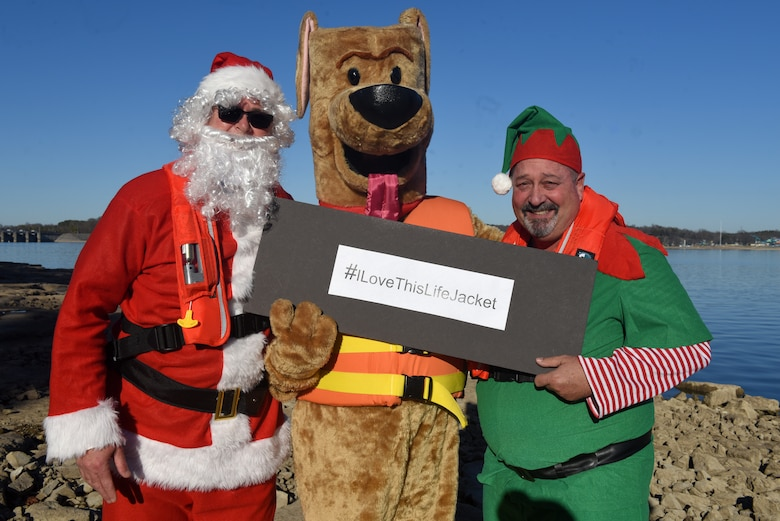 "Safety Santa, Bobber the Water Safety Dog, and Hap ""Hazard"" the Elf film a holiday safety public service announcement Dec. 17, 2018 at J. Percy Priest Lake in Nashville, Tenn., to encourage the public to be vigilant and safe at home this Christmas and when visiting and recreating at Corps of Engineers lakes. (USACE photo by Lee Roberts)"