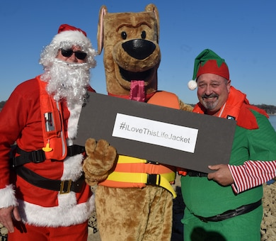 """Safety Santa, Bobber the Water Safety Dog, and Hap """"Hazard"""" the Elf film a holiday safety public service announcement Dec. 17, 2018 at J. Percy Priest Lake in Nashville, Tenn., to encourage the public to be vigilant and safe at home this Christmas and when visiting and recreating at Corps of Engineers lakes. (USACE photo by Lee Roberts)"""
