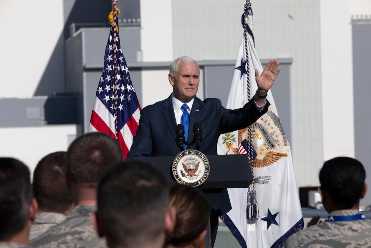 Vice President Mike Pence standing on stage