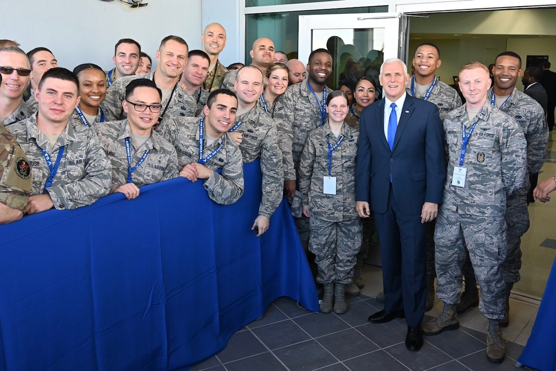 Vice President Mike Pence stands with airmen for a photo