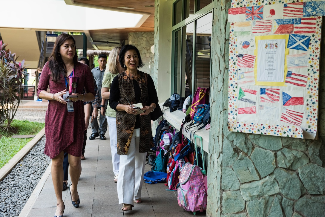 Sharene Brown, spouse of Gen. CQ Brown, Jr., Pacific Air Forces commander, takes a tour of Jakarta Intercultural School, Jakarta, Indonesia, Dec. 13, 2018.